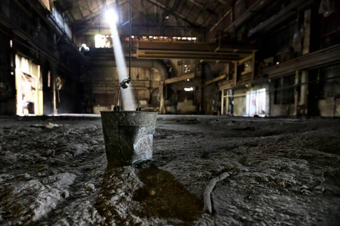 Bucket in beam of light abandoned building