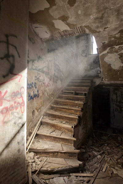 abandoned stairway beam of light