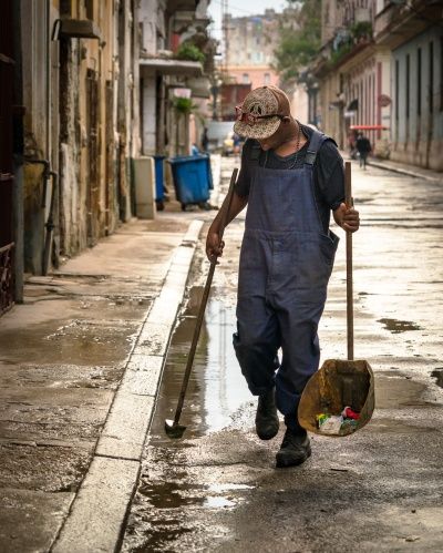 Street cleaner in old Havana going about his day.