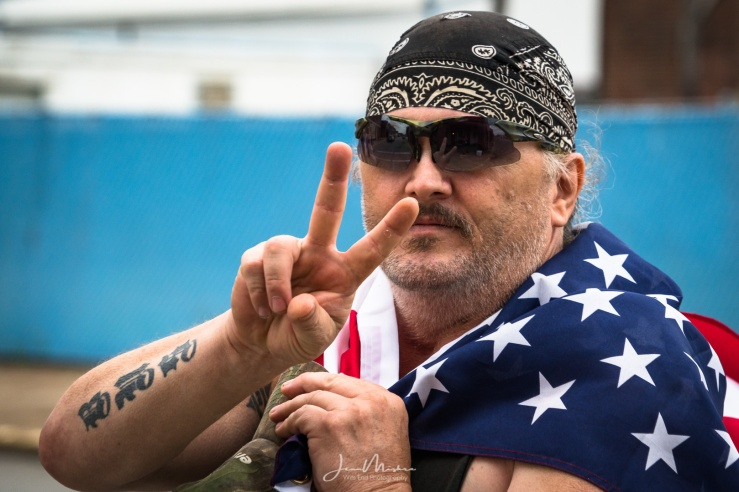 Biker wrapped in flag patriotic