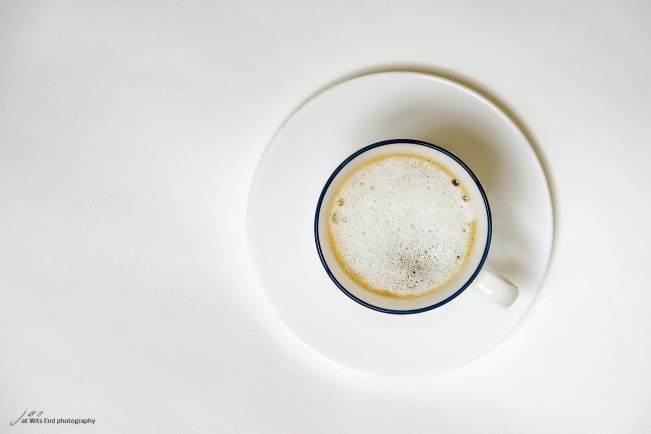 White coffee cup against a white background.