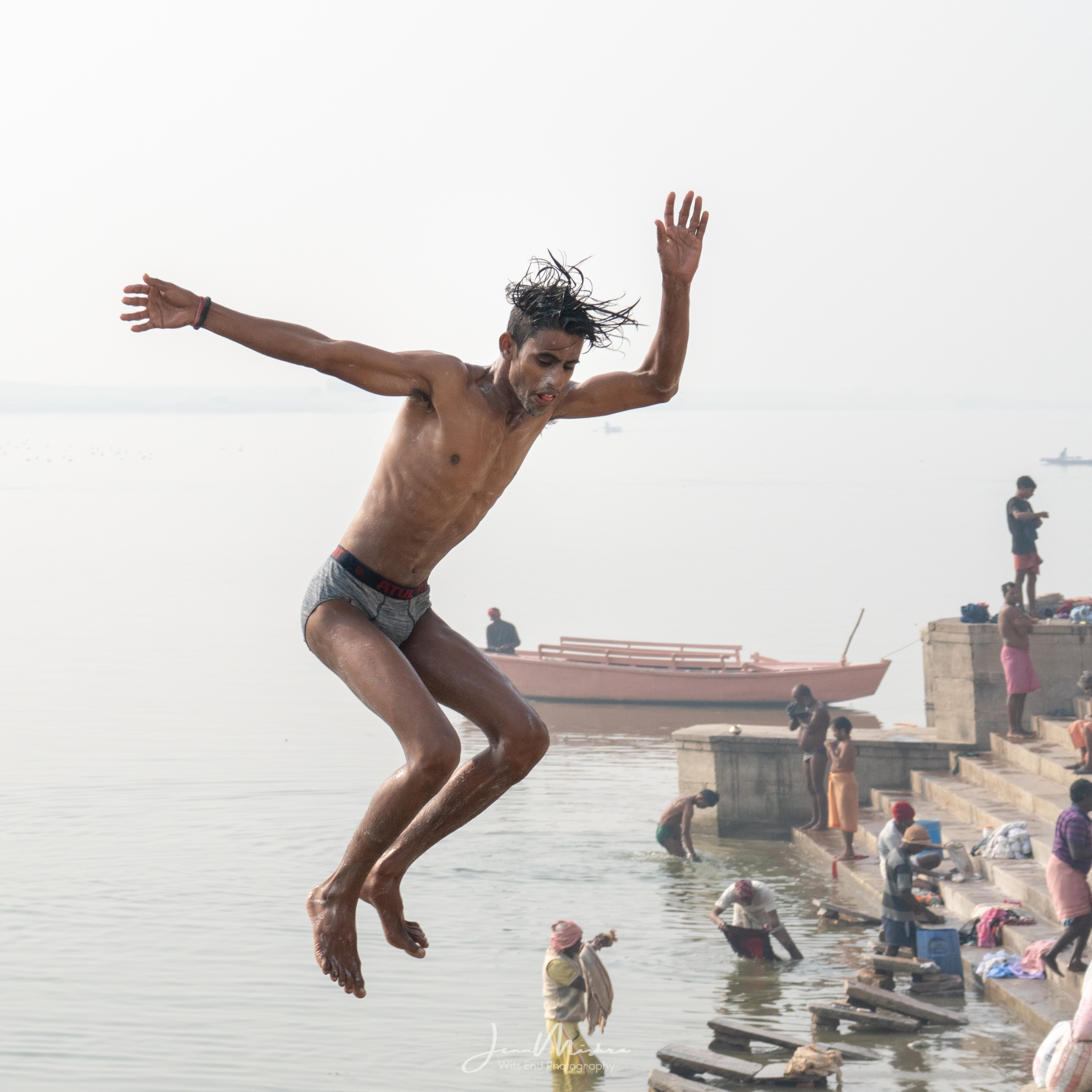 Boy jumping into Ganges River in Varanasi