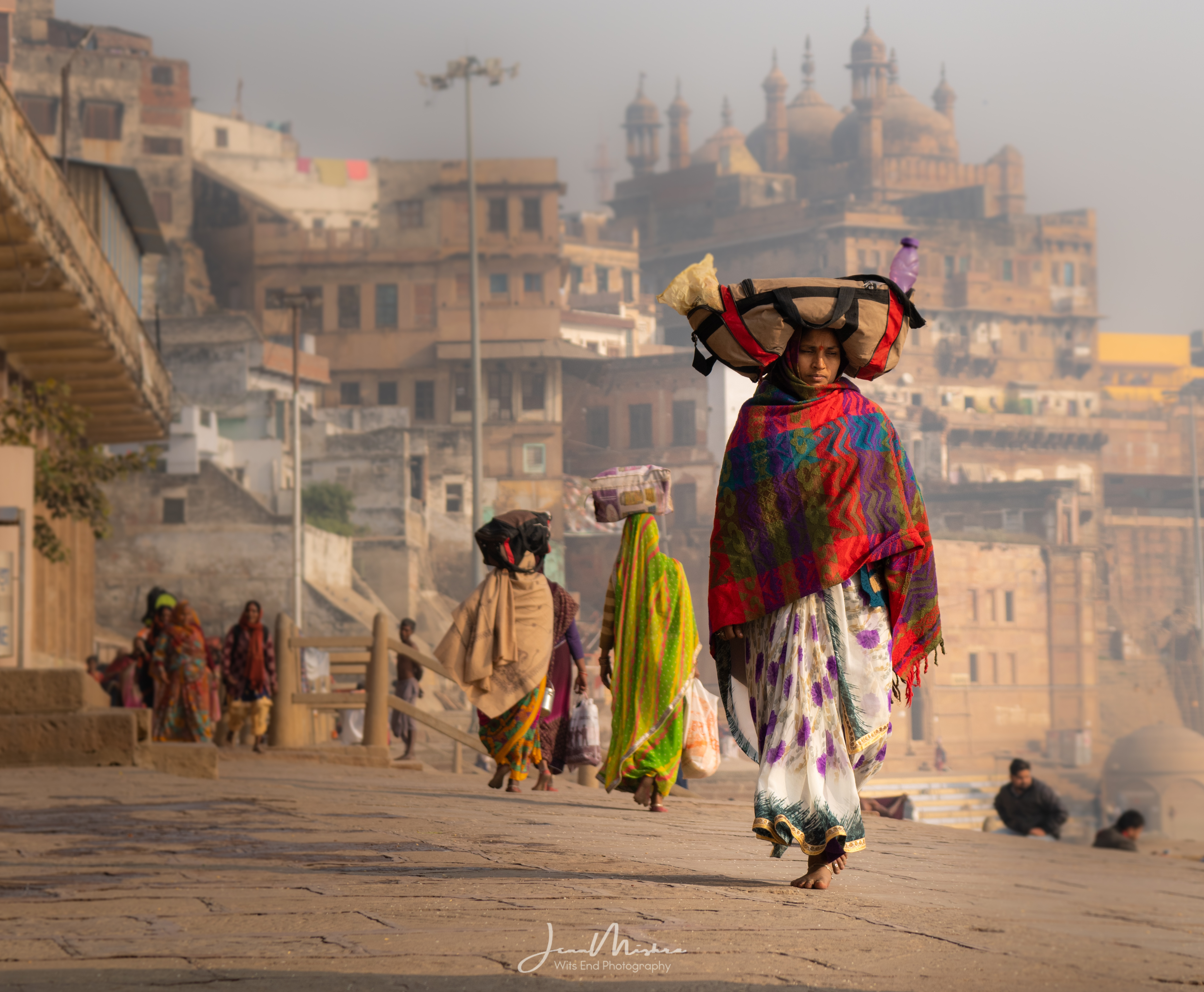 Woman walking the ghats in Varanasi India