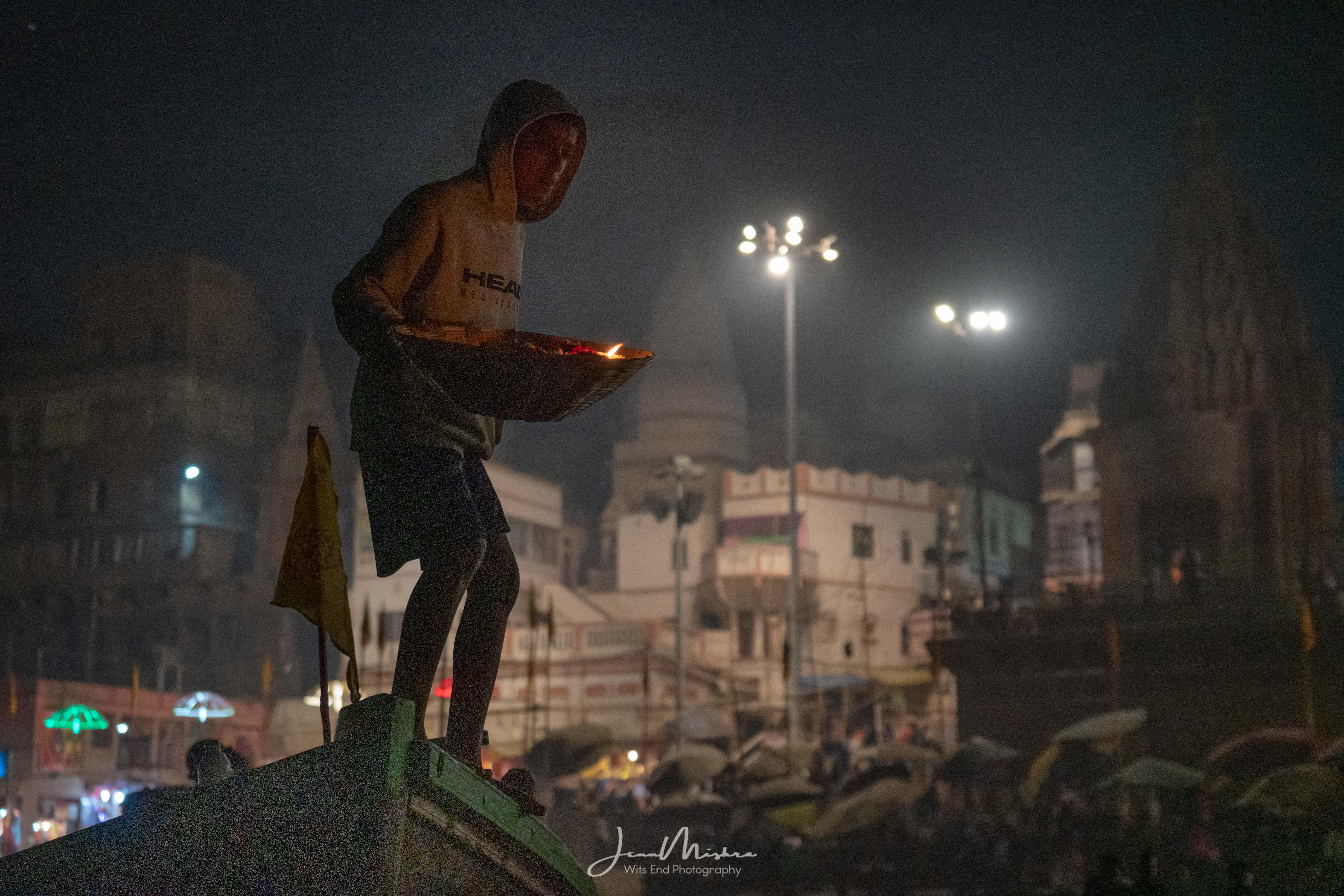Selling offerings Ganga Aarti ceremony Dashashwamedh Ghat in Varanasi India